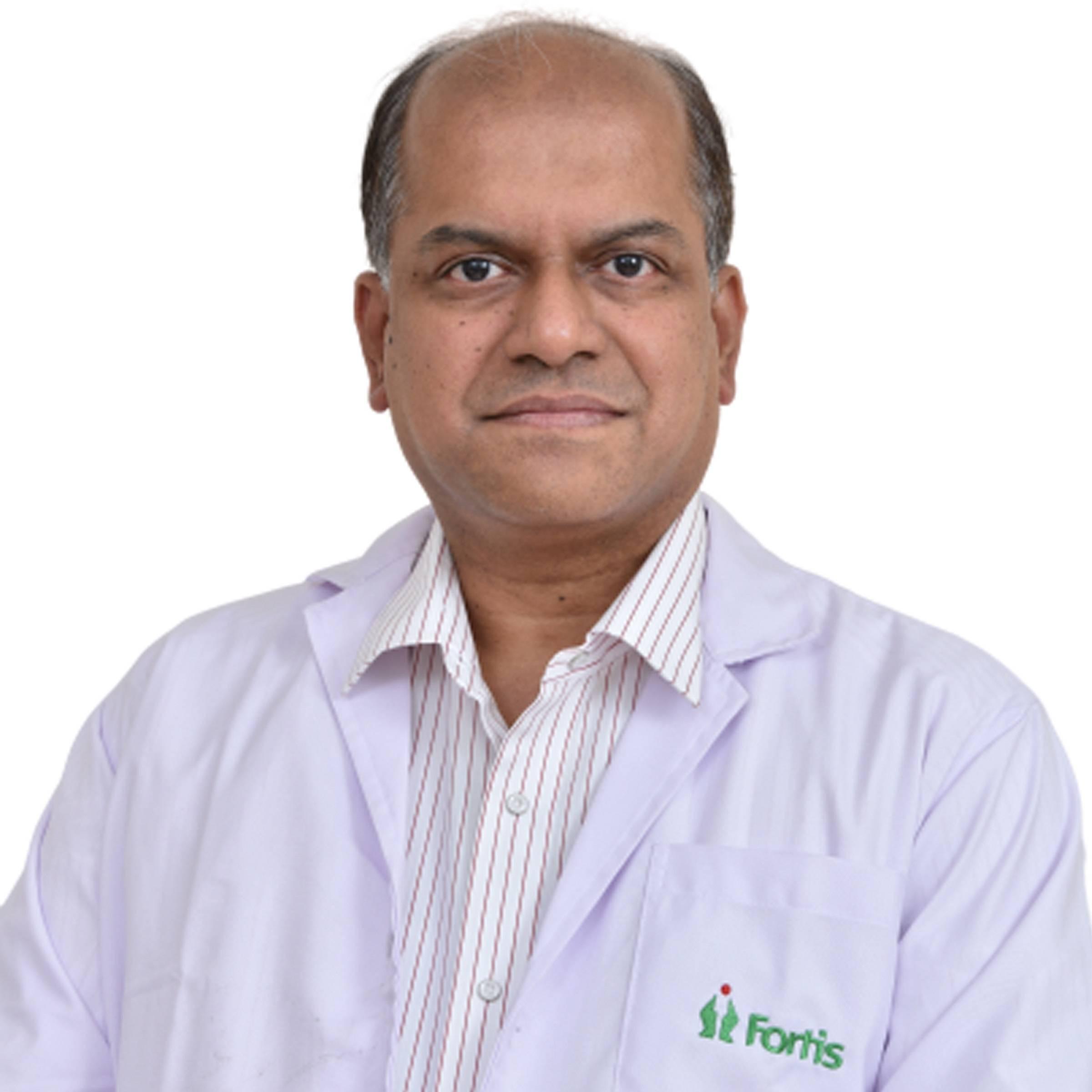 Dr. RAMAN SHENOY
